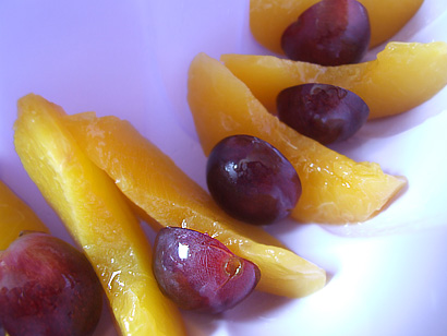 Slices of peaches and grapes
