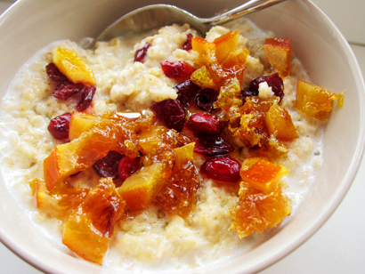 Oatmeal with candied oranges, cranberries, and maple syrup